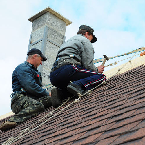 Roofing Contractors Install New House Roofing with Asphalt Shingles Roofing Construction.