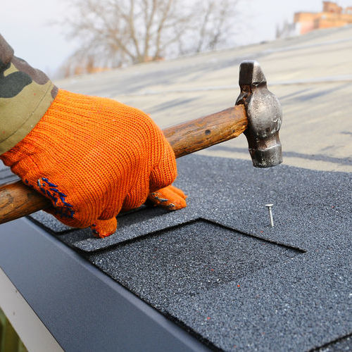 shingle roof getting repaired